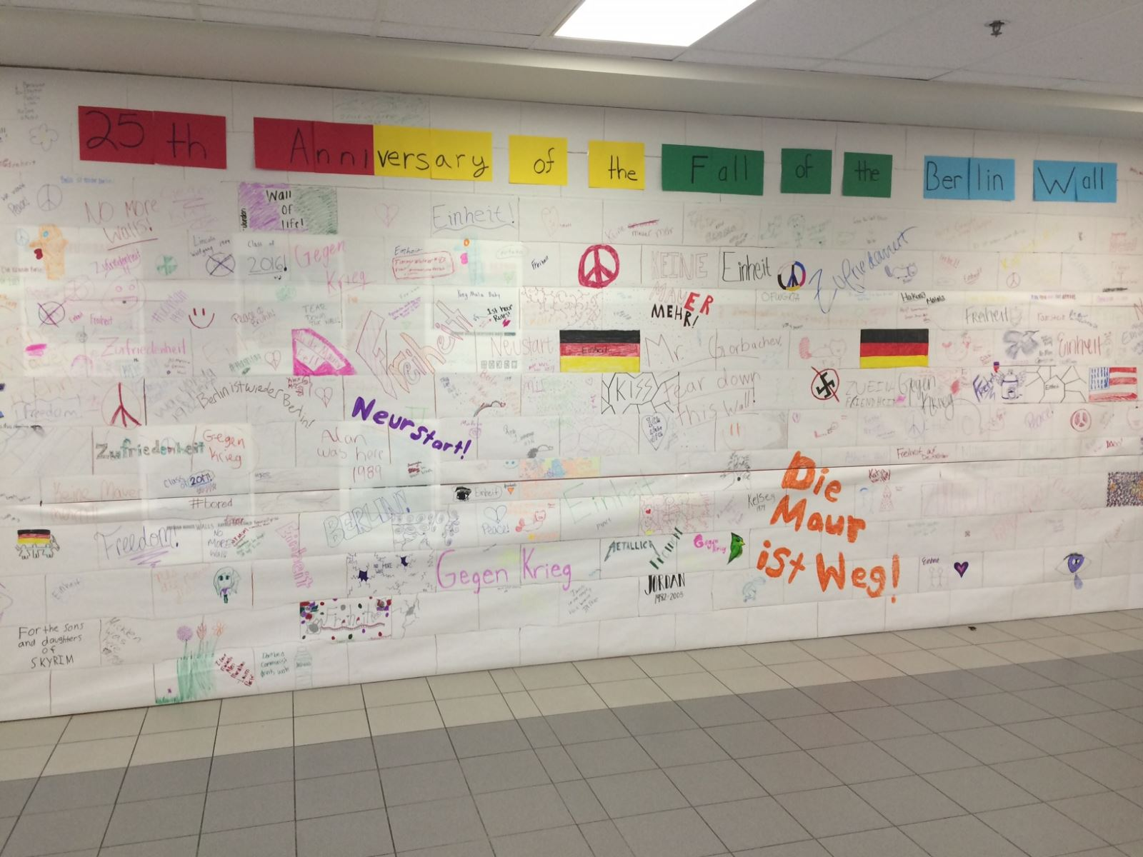 German 1 - Students examined a piece of the Berlin wall, researched some  facts about the graffitti on the wall, saw some photos of it, and discussed  ...